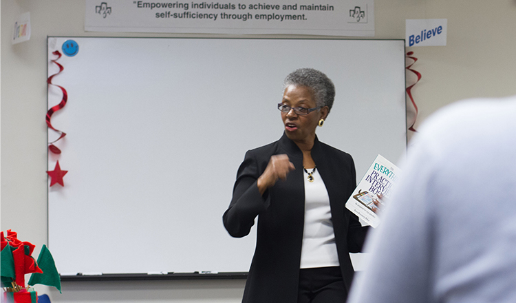 African American woman speaking to classroom