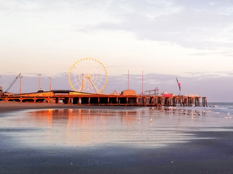 New Jersey boardwalk and ferris wheel at sunset