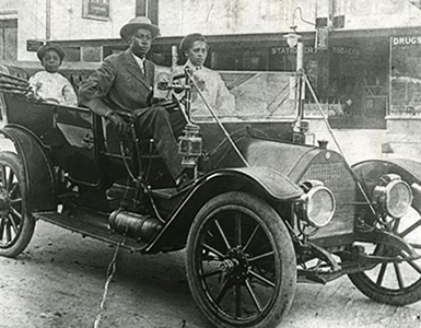 vintage picture of african american family driving car