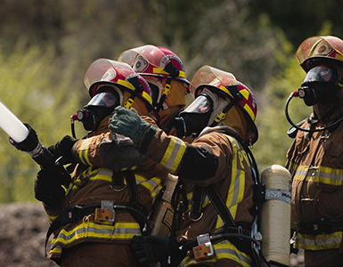 Firefighters shooting water